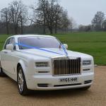 Rolls-Royce with blue ribbon
