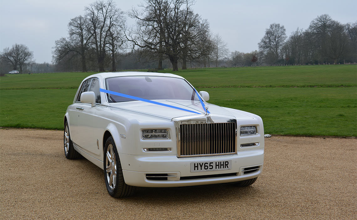 Rolls-Royce with blue ribbon