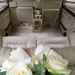 White Fairway London taxi with champagne