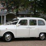 White taxi wedding hire